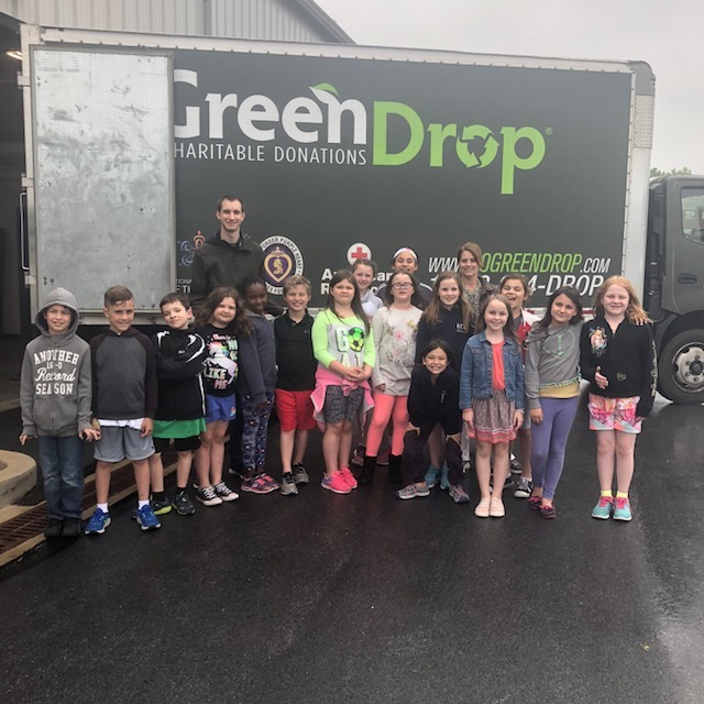 This is the image for the news article titled Green Team's Green Drop Donation Drive
